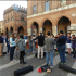 Members of Pioneer High School Orchestras perform in the streets of Cremona. This spontaneous performance sparked interest in the orchestra and encouraged residents to attend their performance.