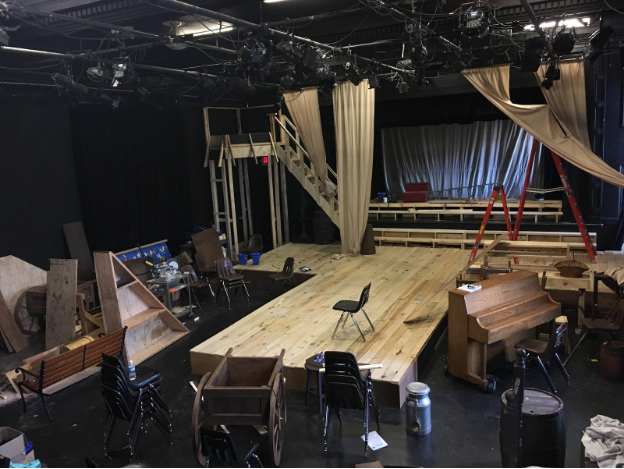 Craft+Theater+is+filled+with+the+great+presence+of+the+new+thrust+stage.+The+stage+was+assembled+with+4-foot+platforms+from+past+shows.+While+the+decking+was+a+two+week+process%2C+the+assembly+of+the+stage+as+a+whole+only+took+a+day.+