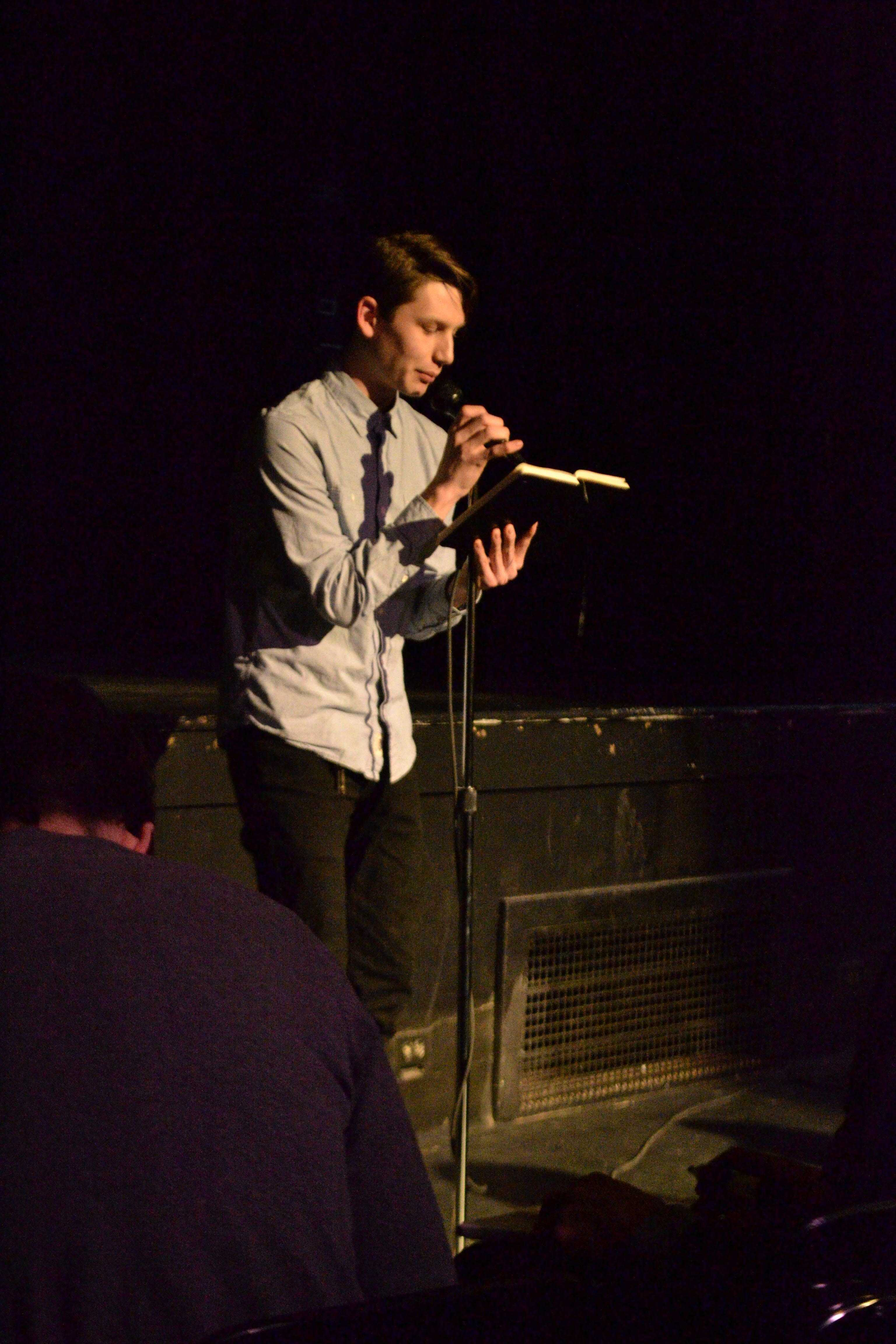Hannon Hylkema reads at the first round of the poetry slam preliminaries