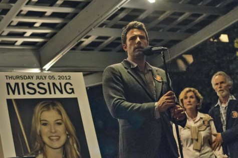 "Ben Affleck gives a public speech beside his in-laws in David Fincher's ""Gone Girl""."