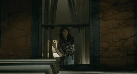 "Samantha (Jocelin Donahue) inside the creepy house she's watching over in ""The House of the Devil."""