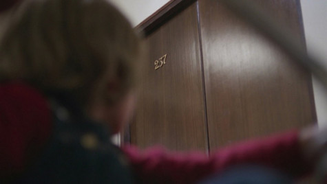 "Danny glancing at Room 237 in ""The Shining."""
