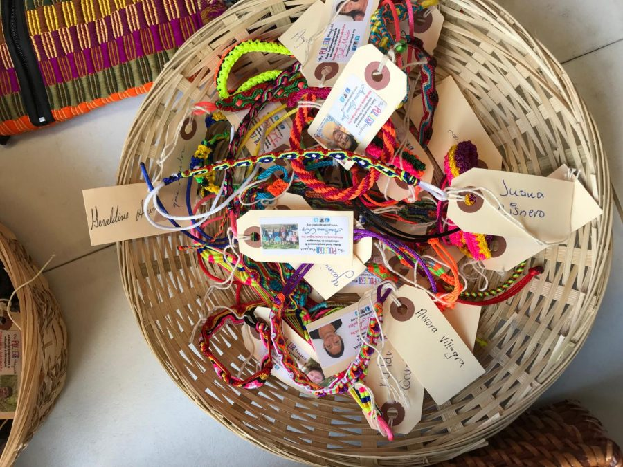 Bracelets+sit+in+a+basket+on+the+third+floor+as+high+school+students+proudly+sell+them.+
